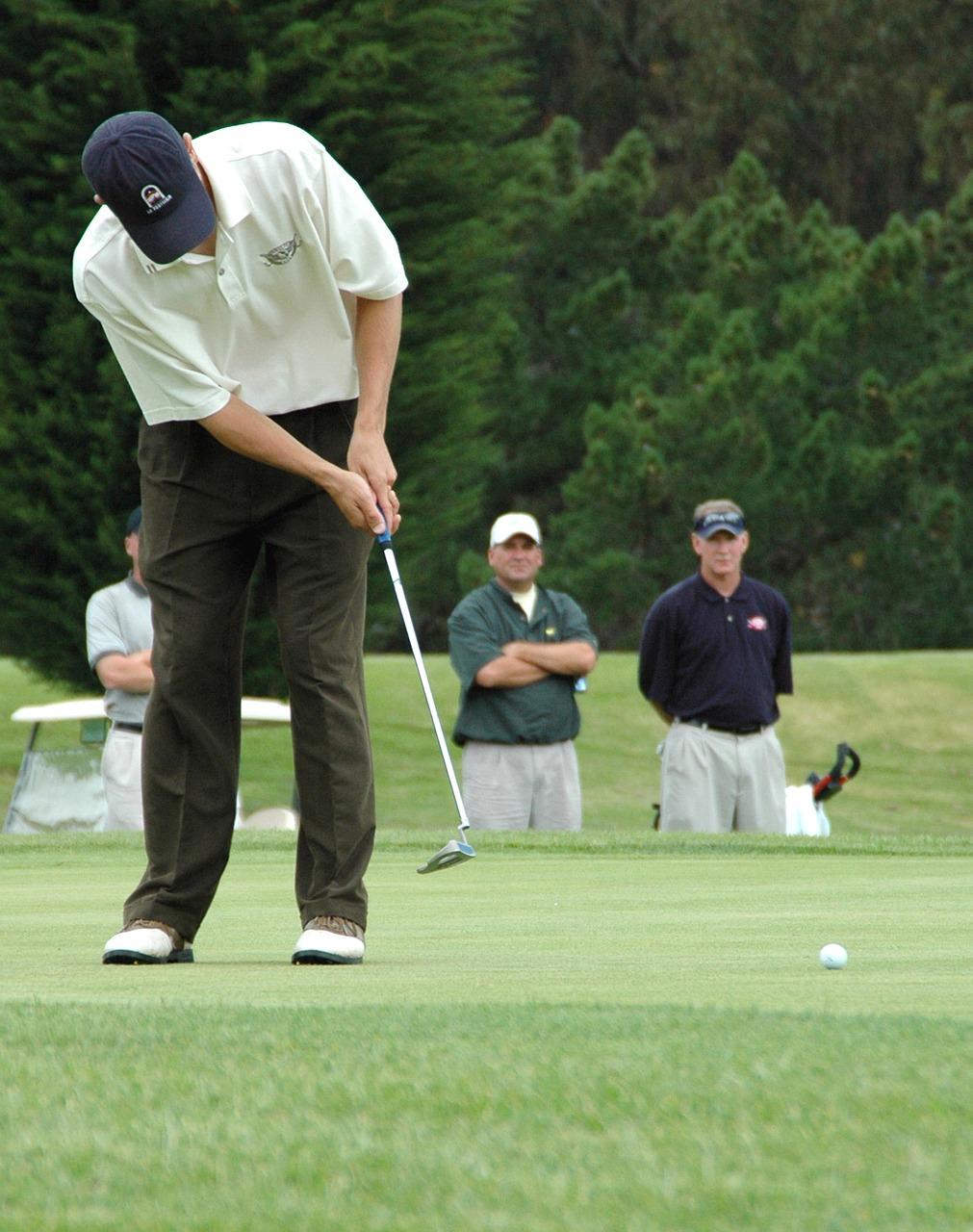 A golfer ready for hitting a tee shot